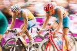 Danylo Sapunov of the Ukraine (23) and Simon de Cuyper of Belgium (28) race during the cycling leg of the men't Olympic triathlon in Hyde Park on Tuesday., Aug. 7, 2012 in London. (Anthony L. Solis/Santa Cruz Sentinel)