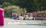 Swimmers pass the feeding station during the first lap of the men's Olympic marathon swim at Hyde Park on Friday, Aug. 10, 2012 in London. (Anthony L. Solis/Santa Cruz Sentinel)