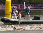 Alex Meyer (20) of Team USA is watched by the race referee during the third lap of the men's Olympic marathon swim at Hyde Park on Friday, Aug. 10, 2012 in London. (Anthony L. Solis/Santa Cruz Sentinel)