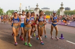 Athletes compete in the women's Olympic race walk in front of Buckingham Palace on Saturday, Aug. 11, 2012 in London. Elena Lashmanova of Russia, second from left in lead pack, came from behind to take the gold medal with a world record time of 1:25:02. (Anthony L. Solis/Santa Cruz Sentinel)