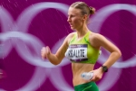 Brigita Virbalyte of Lithuania cools herself off with water during the women's Olympic race walk on Saturday, Aug. 11, 2012 in London. (Anthony L. Solis/Santa Cruz Sentinel)