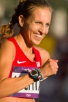 Maria Michta of the U.S. is all smiles as she spots her friends and family in the crowd during the women's Olympic race walk on Saturday, Aug. 11, 2012 inLondon. (Anthony L. Solis/Santa Cruz Sentinel)