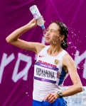 Anisya Kirdyapkina of Russia splashes water on her face during the women's Olympic race walk on Saturday, Aug. 11, 2012 in London. (Anthony L. Solis/Santa Cruz Sentinel)