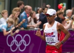 Mebrahtom Keflezighi of the USA takes an early lead halfway through the first of three laps during the men's Olympic marathon on Sunday, Aug. 12, 2012 in London. (Anthony L. Solis/Santa Cruz Sentinel)